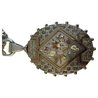 Antique Victorian silver and gold applique  locket