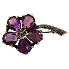 A fine silver and Amethyst flower brooch by Bernard Instone