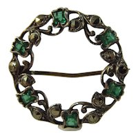 Art Deco vintage halo green paste and marcasite silver brooch