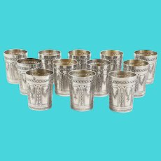 12 French sterling silver alcohol beakers