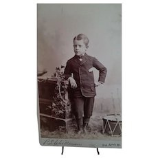 Cabinet Card Photograph of Child with Toy Drum, circa 1885-1895
