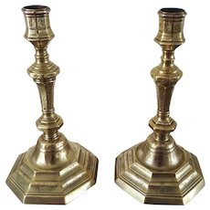 A Pair of late 17th Century engraved Gilt Brass Candlesticks