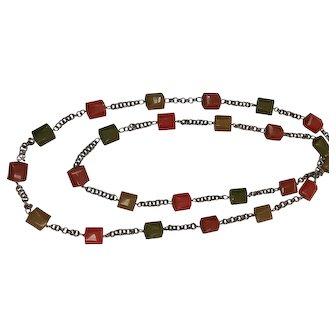 Vintage 58 inch long Bakelite station necklace