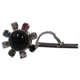 Vintage b.david tie tac with a black center and multi color rhinestone