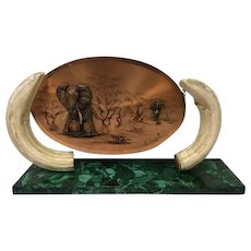 Artificial panel between two imitation tusks on a base of malachite - Provenance unknown - Ca. 1970