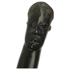 Ebony twisted walking stick / flaneerstok / staff with a grip in the shape of an African man - Ca. 1930