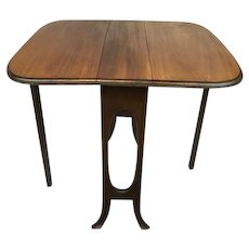 Dropleaf table of teak - England - Ca. 1930