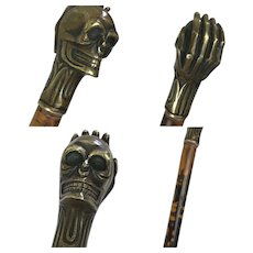 Wooden flamed walking stick with bronze skull - 20th century