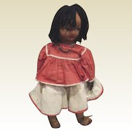 Great black cloth doll with leather hands.