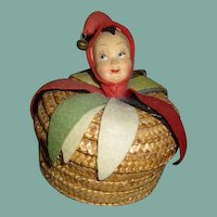 Wonderful molded felt doll head on basket