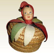 Wonderful molded felt doll head on basket