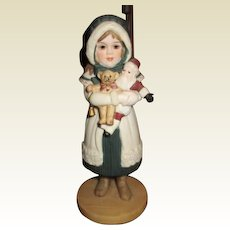 Adorable Jan Hagara girl with a Santa doll