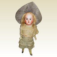 Adorable small bisque doll with her great original dress