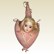 Adorable antique bisque doll  head hanging pillow