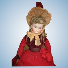 Stunning closed mouth all original made for the French market bisque doll