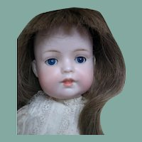 Darling open closed mouth bisque doll