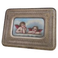 Antique Italian porcelain plaque, daydreaming putti