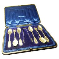Cased antique sterling silver tea spoons and sugar tongs