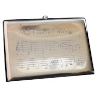 Antique silver cigarette case, musical staves, West Country overture