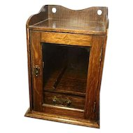 Antique oak smokers cabinet, brass mounts and handles, without key