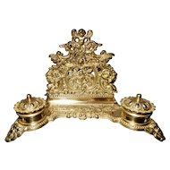 Victorian gilt brass figural ink stand, mask feet and putti