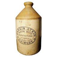 Large Victorian stoneware jug / bottle with original advertising