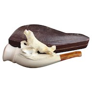 Antique Meerschaum pipe, swimming dog, amber mouthpiece, cased
