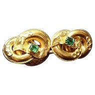 Antique brooch, Victorian lovers knot, 15kt gold and emerald