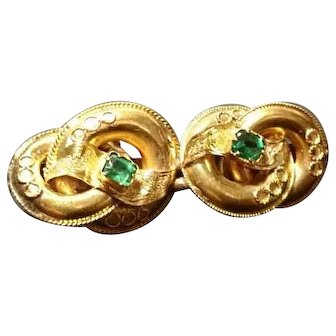 Victorian Etruscan lovers knot brooch, 15kt gold and emerald, double knot