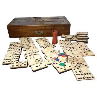 Antique games box, bone dominoes, dice, counters