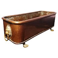 Antique English copper planter, brass lion masks and lion paw feet