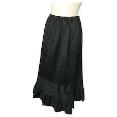 Edwardian black satin skirt, silk pie crust hem