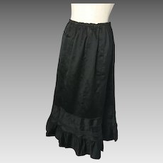 Edwardian black satin skirt, silk pie crust hem