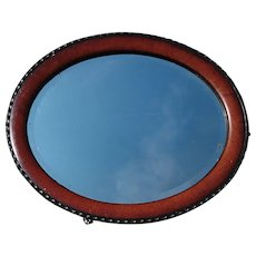 Large Victorian oval mirror, mahogany and ebonised frame, pie crust edge