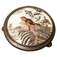Antique pot stand, Victorian aesthetic era, bird ceramic and pewter, trivet
