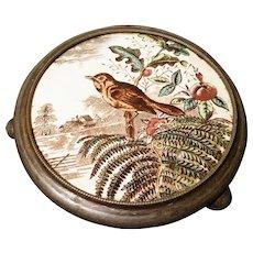 Antique pot stand, Victorian aesthetic era, bird ceramic and pewter, trivet