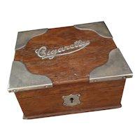 Antique oak and silver cigarette box