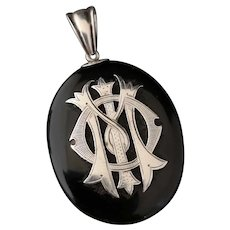Victorian onyx and silver mourning locket, IMO