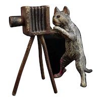 Antique bronze cat and camera, Bergman