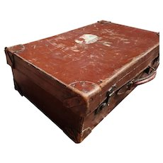 Antique tooled leather suitcase