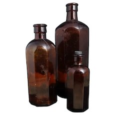 Antique brown glass bottles, hexagonal, medical, apothecary