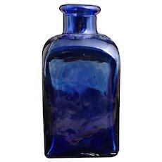 Antique cobalt blue glass medicine bottle
