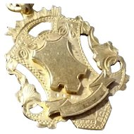 Vintage silver gilt shield watch fob