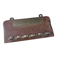 Antique Arts and Crafts pipe rack