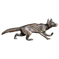 Antique bronze stalking fox figure