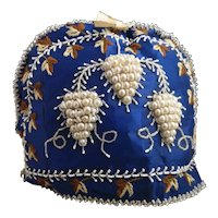 Antique Victorian beadwork and embroidered tea cozie, grapes