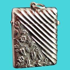Antique Victorian silver vesta case, wrythen and flora
