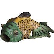 A charming glazed terracotta fish