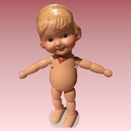 Early wood segmented character doll.