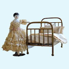 Victorian Brass Doll's Bed with linens and tiny China Head Doll